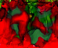 Abstract painted red green merging smudged. Colorful background hand drawn with bright inks and watercolor paints. Color splashes and splatters create uneven Royalty Free Stock Photo