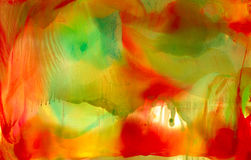 Abstract painted smooth smudged red green. Colorful background hand drawn with bright inks and watercolor paints. Color splashes and splatters create uneven Royalty Free Stock Images