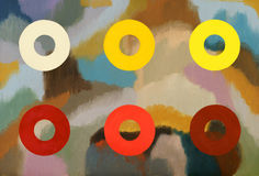 An abstract painting with bright rings of color. An abstract painting; bright rings of color floating on a background of ill defined dull coloured areas Stock Images