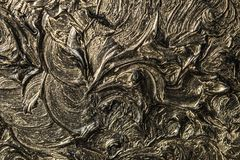 Abstract painting on canvas. Black colors and gold. Background. Stock Photography