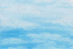 Cloudy sky Watercolor hand-made painting. This is abstract painting of cloudy blue sky. There are many blurry white clouds on a light-blue background Stock Images