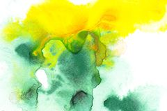 Abstract painting with green and yellow watercolor paint blots. On white royalty free stock photos