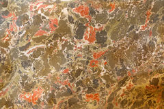 Abstract painting. Marble effect painting. Mixed red and green oil paints. Unusual handmade background for poster, card, invitation, texture Stock Photography