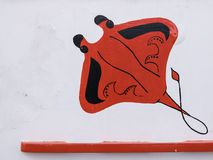 Abstract painting of a red manta on a white board royalty free stock image