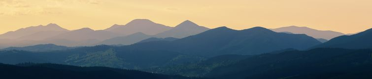 Abstract panoramic mountain landscape, tonal perspective at suns. Et, decorative artistic look stock photography