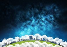 Modern city space view. Abstract panoramic view at planet Earth in clouds with buildings and aerostats from space. Dark space haze on background Stock Photography