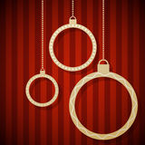 Abstract paper Christmas balls. Hanging against red striped background Stock Images