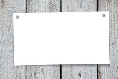 Paper note, wooden background Royalty Free Stock Image