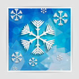 Abstract paper snowflakes on blue geometric background with tria Stock Photo