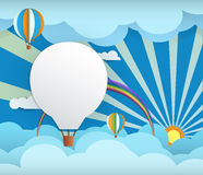 Abstract paper-sunshine- rainbow-cloud -balloon. Abstract paper with sunshine- cloud and balloon on light blue background with space for design.Flat design style Stock Photography