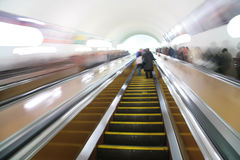 Abstract passengers on escalator. Royalty Free Stock Photo
