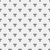Abstract pattern. Black radiation signs on a white background. Irradiation. Dangerous area. Vector illustration in a flat style Stock Image