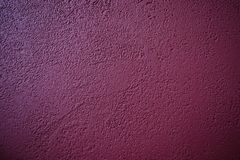 Abstract pattern of concrete burgundy color. Painted plastered wall. Grunge decorative pale.  royalty free stock photos