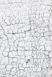 Abstract pattern of cracks in white washed wall Stock Photo