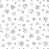 Abstract pattern of falling snowflakes. Seamless pattern of falling silver snowflakes on white background. Elegant pattern for banner, greeting, Christmas and Royalty Free Stock Image
