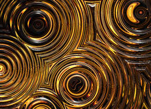 Abstract pattern of golden wet symmetrical ripple circles Stock Photography