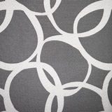Abstract pattern of interlocking circles. Abstract pattern of interlocking irregular white circles on a grey lived background Royalty Free Stock Photography