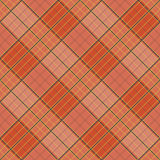 Abstract Pattern with Plaid Fabric on a bright orange background. Stock Photo
