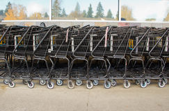 Abstract Pattern of Shopping Carts at Supermarket. Multiple shopping carts stacked outside of grocery store Royalty Free Stock Photo