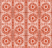 Abstract pattern with stylized red flowers. Mosaic pattern of polygons with circular objects resembling flowers Royalty Free Stock Image