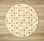 Abstract pattern themed round tray on the wooden background Royalty Free Stock Image