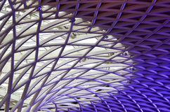 Abstract pattern of white and purple metal pipes. A close-up shot of a metal lattice of white and purple pipes. They form part of a ceiling decoration Stock Photos