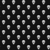 Abstract pattern. White skulls on a black background. Death in the dark. Vector illustration in a flat style. EPS 8 Royalty Free Stock Photos