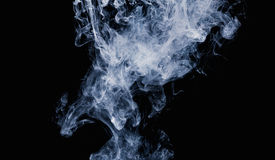 Abstract pattern of white smoke on a black background. Waves of mist and clouds. Royalty Free Stock Photography
