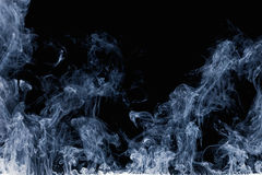 Abstract pattern of white smoke on a black background. Waves of mist and clouds. Royalty Free Stock Images