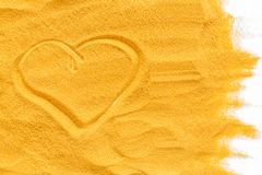 Abstract pattern with yellow sand texture and love picture top view.  stock photo