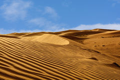 Abstract patterns in the dunes of Arabian desert Royalty Free Stock Image