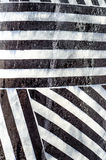 Abstract patterns and texture. Abstract lines and stripes with patterns and texture made from a building wall. Black and white royalty free stock photo