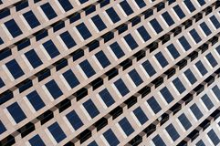 Abstract patterns of Windows. Image of windows on the exterior of a skyscraper Stock Photos