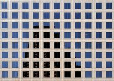 Abstract patterns of Windows - 2. Image of windows on the exterior of a skyscraper. Reflection of buildings add to a sense of cityscape Royalty Free Stock Image