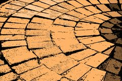 Abstract paving in earthy tones. Cutout image of paving stones in circular arrangement in earthy tones royalty free stock photography