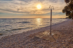 Abstract Pebble Beach Shower at Sunset Royalty Free Stock Photo