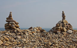 Abstract Pebble and Rock Sculptures on the beach Stock Photos