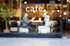Abstract people in coffee shop and text cafe in front of mirror, soft and blur concept Royalty Free Stock Image