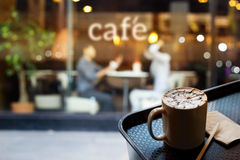 Abstract people in coffee shop and text cafe in front of mirror, soft focus. Abstract people in coffee shop and text cafe in front of mirro Royalty Free Stock Image