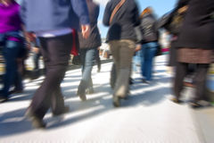 Abstract people in rush hour. Abstract people walking motion blur over millenium bridge in london Stock Photos