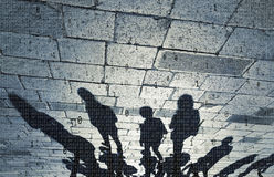 Abstract people shadows with binary code background. Shadows of group of people walking with conceptual binary zero and one number code background. Conceptual Stock Photos