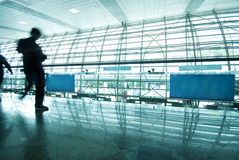 Abstract of people walking. At airport in blue tone Royalty Free Stock Images