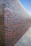 Abstract perspective of tall brick wall Royalty Free Stock Photo