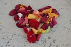 Abstract petal roses heart. Petal roses of different colours forming a heart Royalty Free Stock Photo