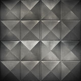 Abstract photo background with black metal wall. With square relief pattern Stock Image