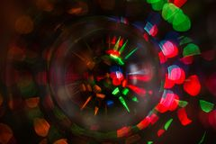 Abstract photo of blurry light sources of different colors twisted into a circle royalty free stock photos
