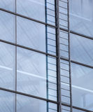 Contemporary Building with Blue Windows and Ladder Stock Photography