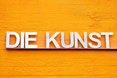 Yellow version of DIE KUNST with different colors royalty free stock photography