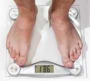 Abstract photo of dieting. Mans leg on scale. Abstract photo of dieting Royalty Free Stock Images