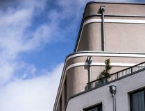 Abstract photo of the facade of a large building with three downpipes for rainwater flowing off the roof. Germany Stock Photos